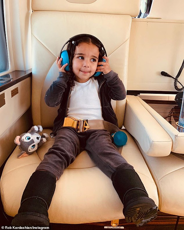 Ready for takeoff: Dream rested with a pair of protective headphones to wear on the noisy ride in a photo from her father's Instagram account