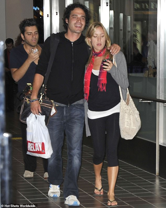 Under wraps: Miguel and Kristin are shown at Los Angeles International Airport in June 2010 after arriving on a flight from Canada